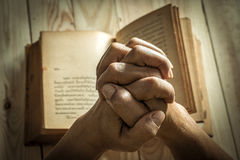 Unrecognizable woman holding a bible in her hands and praying Royalty Free Stock Photography
