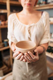 Unrecognizable woman holding empty bowl, void Stock Photo