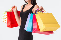 Unrecognizable woman holding multicolored shopping bags Stock Photography