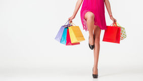 Unrecognizable woman holding multicolored shopping bags Stock Images