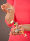 Unrecognizable woman pouring puzzles Royalty Free Stock Photography