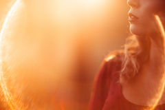 Unrecognizable woman profile, lens flare Royalty Free Stock Photography