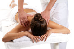 Unrecognizable woman receiving massage treatment. Unrecognizable woman receiving massage relax treatment close-up from male hands royalty free stock photo