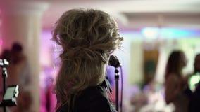 Unrecognizable woman singer on concert. Shot stock video