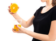 Unrecognizable woman squeezing orange Royalty Free Stock Photography