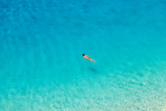 Unrecognizable woman swimming at Porto Katsiki beach Stock Image