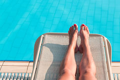 Unrecognizable woman tanning near pool Stock Photo