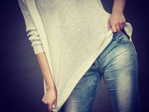 Unrecognizable woman wearing too big jumper Stock Image