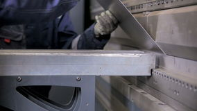 Unrecognizable workers operating bending equipment, bending metall sheets at a industrial factory. Metal bending machine. Unrecognizable worker operating bend stock video footage