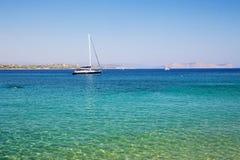 Unrecognizable yacht and   coast of  wonderful Greek island royalty free stock image