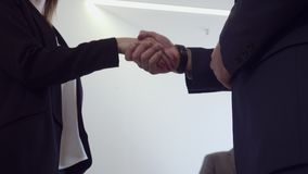 Unrecognizable young business woman and man in formal wearing shaking hands. Business cooperation concept stock video