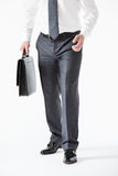 Unrecognizable young businessman holding  a briefcase Royalty Free Stock Photo