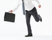 Unrecognizable young businessman running with a briefcase Stock Photo