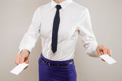 Unrecognizable young businesswoman dispensing business cards Stock Photography