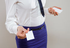 Unrecognizable young businesswoman dispensing business cards Stock Image