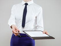 Unrecognizable young businesswoman  holding documents and a pen Stock Images