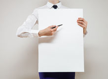 Unrecognizable young businesswoman holding a white poster Stock Photo