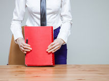 Unrecognizable young businesswoman on workplace with folders Stock Photo