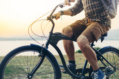 Unrecognizable Young Man Is Cycling Along The Shore Against The Backdrop Of The Sunset Vacation Holiday Activity Concept Stock Images