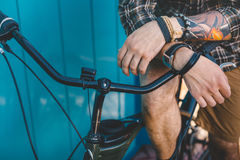 Unrecognizable Young Man Sitting On A Bicycle Near Blue Wall Background Daily Lifestyle Urban Resting Concept Royalty Free Stock Photography