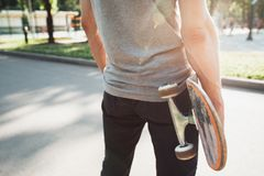 Unrecognizable young man with skateboard Royalty Free Stock Images