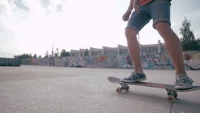 Unrecognizable young man skateboarding. Close-up. SLOW MOTION. stock footage