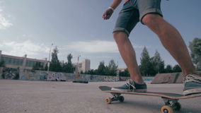 Unrecognizable young man skateboarding. Close-up. SLOW MOTION. stock video footage