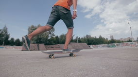 Unrecognizable young man skateboarding. Close-up. SLOW MOTION. stock video