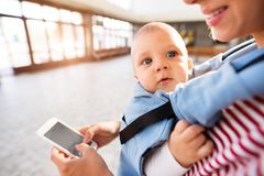 Young mother with smartphone and baby travelling. Stock Photo