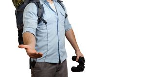 Uunrecognizable Young Traveler Man With A Baclpack And Binoculars, Stretches Out His Hand Isolated. Help In Travel Concept royalty free stock photo