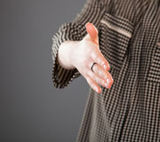 Unrecognizable young woman efforing handshake. Grey background Stock Images