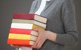 Unrecognizable young woman holding books Royalty Free Stock Photo