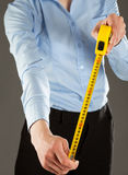 Unrecognizable young woman holding a tape measure Royalty Free Stock Image