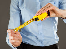 Unrecognizable young woman holding a tape measure Stock Photos