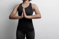 Unrecognizable young woman. In sportswear practicing yoga at home stock photography