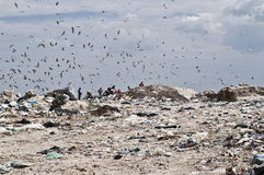 Unrecognizble people on landfill Stock Photography