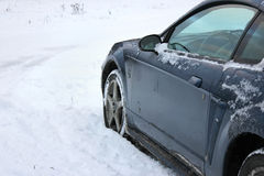 Unrecognizeable car stuck in the snowfield Stock Photography