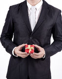 Unrecognized Businessman holding Birthday Gift. Businessman with gift box isolated on white Royalty Free Stock Photos