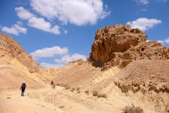 Two hikers in Negev desert. Stock Photo