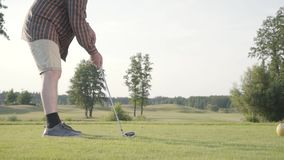 Unrecognized man playing golf on the golf course. The concept of recreation and sports outdoors. stock video