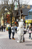 Unrecognized man portrays the role of a teddy bear. ZAKOPANE, POLAND - MARCH 09, 2016: Unrecognized man portrays the role of a teddy bear, tourists eagerly wants Royalty Free Stock Image