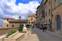 Unrecognized people go along Via Donna Felicissima in San Marino. San Marino, Italy - August 22, 2015: View of Via Donna Felicissima in sunny day. Unrecognized Royalty Free Stock Photo