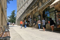 Unrecognized people near shop on Via Eugippo in San Marino. San Marino, Italy - August 22, 2015: Group of unrecognized people near shop on Via Eugippo Stock Photo