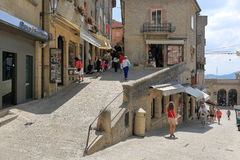 Unrecognized people on a street in San Marino, Italy. San Marino, Italy - August 22, 2015: Unrecognized people walk along Contrada Santa Croce Royalty Free Stock Photo