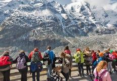 People visit observation platform of Grossglockner Pasterze Glacier in Austria. Stock Images