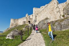People visit Spis Castle in Spisske Podhradie, Slovakia. Unrecognized people visit Spis Castle courtyard. Spissky hrad, National Cultural Monument UNESCO, is royalty free stock photo