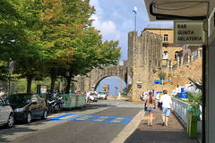 Unrecognized people walk along Viale Antonio Onofri in San Marino. San Marino, Italy - August 22, 2015: Entrance to the Fortress of San Marino. Unrecognized Stock Image