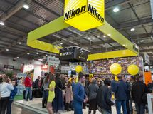 Nikon booth during CEE 2017 in Kiev, Ukraine. Unrecognized visitors testing professional photographic cameras on Nikon booth during CEE 2017, the largest stock images