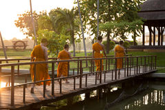 Unrecognized Young buddhist monks walking a cross the bridge. In the morning Royalty Free Stock Image