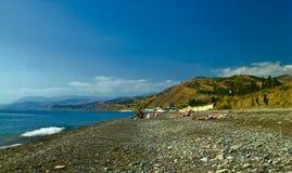 Unrecognizible people on the Black Sea beach Stock Photos
